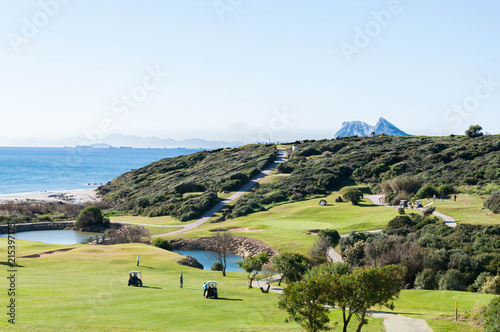 Spoed Foto op Canvas Mediterraans Europa Beach and golf field in La Alcaidesa, Costa del Sol, Spain