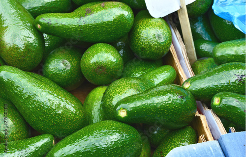 Green and fresh avocado for sell in the market. - 215402110