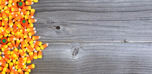 Halloween Candy On Weathered Wood In Flat Lay Format With Copy Space