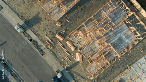 Fotomural Drone Aerial View of Home Construction Site Foundations and Framing