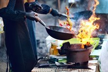 Cooking Food On Fire On Street Festival