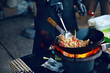 canvas print picture - Cooking Food On Fire On Street Festival