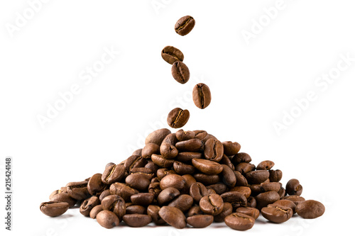 Leinwand Poster A bunch of coffee beans and falling coffee beans on a white background