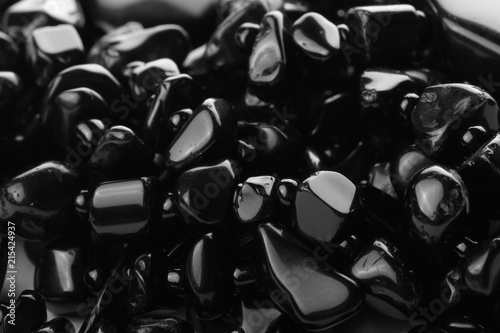 Decorative women's beads of black stones close-up. Abstract background