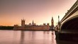 Timelapse of Big Ben and the British Parliament during sunset with reflections in the calm Thames River