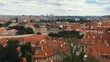 Beautiful panorama of old Prague with red roofs and big clouds