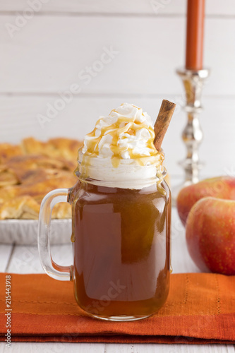 Hot Caramel Apple Cider with an Apple Pie and Cinnamon Stick