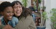 portrait of young woman surprise hugging friend diverse girlfriends embracing laughing enjoying friendship hang out together in urban background