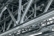 Framework Detail Of Metal Railroad Bridge. Closeup Bottom View