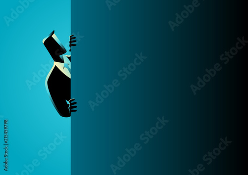 Fotografía Businessman peeking from behind wall