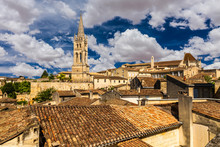 View Of The Bell Tower Of The Monolithic Church In Saint Emilion, Bordeaux, France