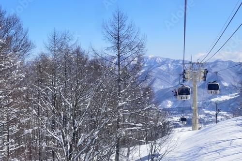 Fotobehang Gondolas Panoramic ski at hakuba happo in Nagano Japan with blue and gondola