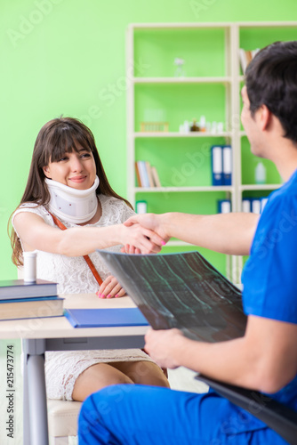 Female patient visiting male doctor in medical concept