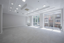 Spotlight And Empty Space, Empty Space, The Interior Of An Office Or Apartment With Three Windows , The Interior Is In Light Colors