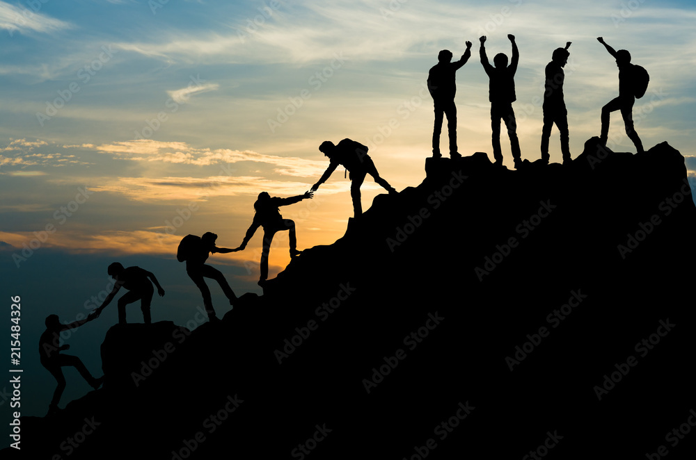 Fototapeta Group of people on peak mountain climbing helping team work , travel trekking success business concept