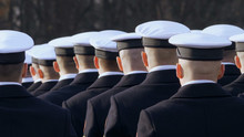 White Caps Are Dressed For Soldiers, Stand In Line And Look At The Commander