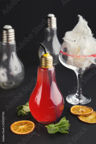 Staande foto Cocktail Red cocktail in bulb glass and cotton candy