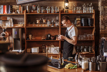 A Waiter Is Holding Glass Dish In The Coffee Bar