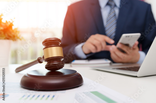 Photo Justice symbol wooden gavel on table. Attorney working in office