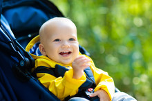 Baby Boy In Stroller In Autumn...
