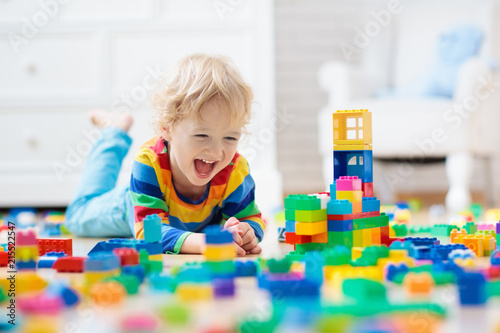 Obraz Child playing with toy blocks. Toys for kids. - fototapety do salonu