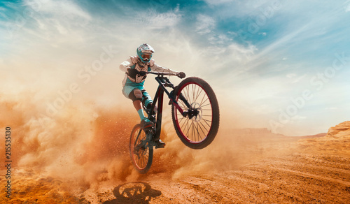 Fototapeta Cyclist riding a bicycle. Downhill. obraz