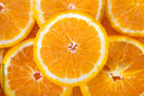 Foto op Aluminium Vruchten Colorful orange citrus fruit slices background top view