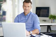 Businessman Working On Laptop ...