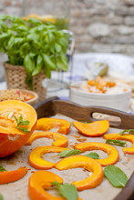 Lunch At Home Outdoors In The Courtyard. Autumn Vegetables And Fruits. Baked Pumpkin With Honey And Spices. Copy Space,