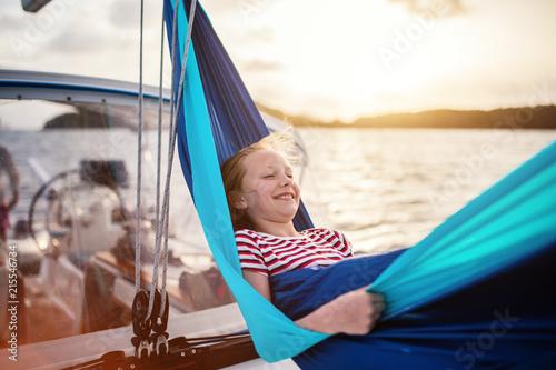 Cute girl on board of sailing yacht