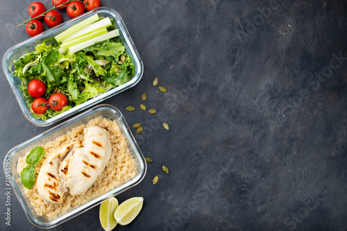 Fototapeta Healthy meal prep containers with quinoa, chicken breast and green salad overhead shot with copy space. Top view. Flat lay obraz