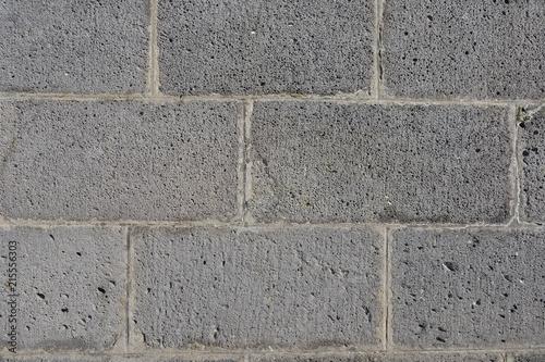 Fotobehang Grijs Mur de parpaings gris