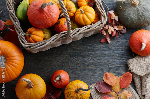 Deurstickers Franse bulldog Wicker basket with colorful pumpkins and gourds for Halloween and Thanksgiving, holiday decoration