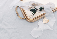 Wedding Rings On Gold Tray With Olive Branch. Stylish Wedding Concept