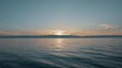 Calm water of lake Baikal at sunset golden hour.
