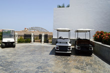 White Electric Golf Cars Are P...