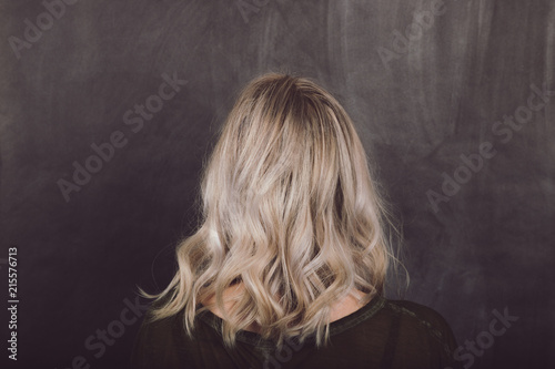 Fotografie, Obraz  Woman With Mid Length Blonde Wavy Shadow Root Hairstyle