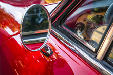 Side Mirror Of A Vintage Red Car