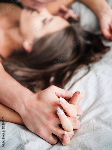 Focused on hands of passion couple having sex