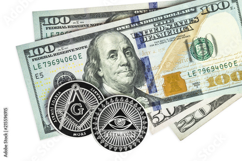 Fényképezés  Freemason symbol coin on hundred dollar bills