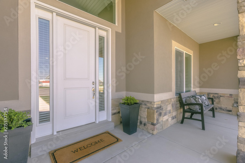 Fotografie, Obraz  White front door with welcome mat on patio