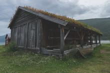Old Rustic Buildings In Coastal Norway In Fishing Village