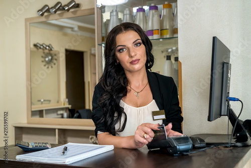 Fototapety, obrazy: Administrator in beauty salon making payment with terminal