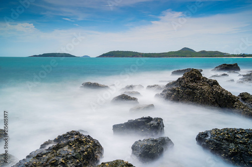 Photographie  Long exposure shot of rocks on the sea