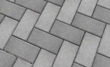 3D Realistic Render Of Grey Lock Paving Texture.