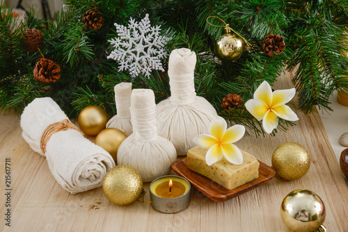 Poster Spa Christmas spa with Composition of spa treatment and wooden background