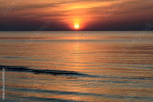 Fotobehang Diepbruine Beatiful sunset in the baltic sea
