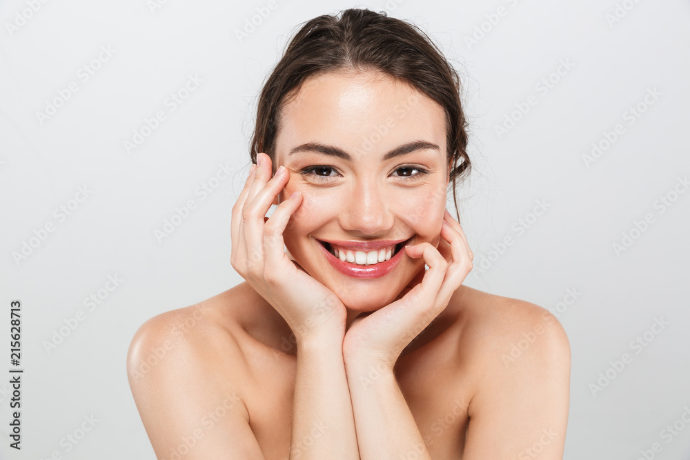 Fototapeta Beauty portrait of a smiling young topless woman