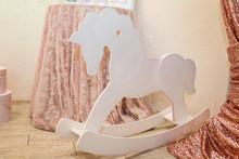 White Toy Rocking Horse On The...