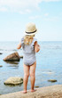 Little girl in hat walking beach sunny summer day, Instagram style, fashion, Latvia, Vidzeme, Baltic Sea